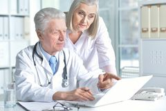 Male and female doctors working. Portrait of male and female doctors working Royalty Free Stock Photos