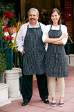 Portrait Of Male And Female Florist Outside Shop Stock Image