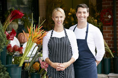 Portrait Of Male And Female Florist Outside Shop Stock Images