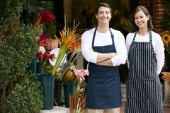 Portrait Of Male And Female Florist Outside Shop Royalty Free Stock Photos