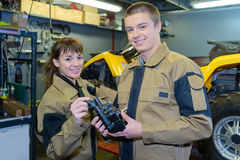Portrait male and female mechanics Royalty Free Stock Images