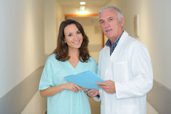 Portrait male and female medics in hospital corridor Royalty Free Stock Photo