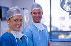 Portrait of male and female nurse smiling in operation theater Royalty Free Stock Photo