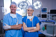 Portrait of male and female nurse standing in operation theater Royalty Free Stock Photos