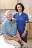 Portrait of male and female osteopath Stock Photography