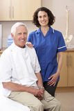 Portrait of male and female osteopath Stock Images