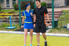 Portrait of male and female tennis players Stock Image