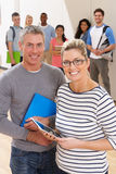 Portrait Of Male And Female Tutors In Class With Students. Smiling Stock Photos