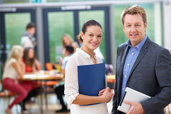 Portrait Of Male And Female Tutors In Classroom Royalty Free Stock Photos