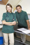 Portrait Of Male And Female Vets In Surgery. Smiling and looking at camera Stock Photos