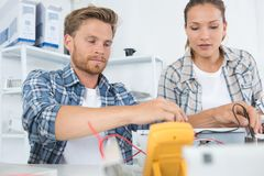 Portrait male and female workers selective focus Stock Image