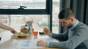 Portrait of male financial analytic working in the cafe. Concept of: business peope, cafe table, modern interior, charts and graphs, financial planning stock video