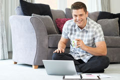 Portrait Of Male Freelance Worker Using Laptop At Home. Male Freelance Worker Using Laptop At Home Stock Photography