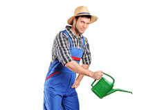 Portrait of a male gardener with watering can Royalty Free Stock Photos