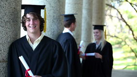Portrait of a male graduate stock video