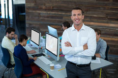 Portrait of male graphic designer standing with arms crossed Royalty Free Stock Image