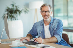 Portrait of male graphic designer using graphics tablet. In office stock photos