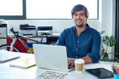 Portrait of male graphic designer working on laptop Royalty Free Stock Photos