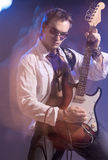 Portrait of Male Guitarist Playing with Expression. Shot with St Stock Photography