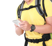 Portrait of male hiker hand with backpack using mobile phone. Isolated on white background Stock Image