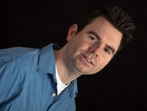 Portrait of male in his 30's on black background Royalty Free Stock Photos