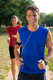 Portrait Of A Male Jogger Listening Music Royalty Free Stock Images