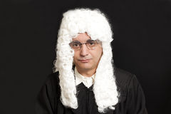 Portrait Of Male Judge in a wig on black. Background stock photos