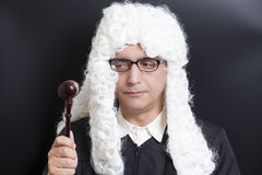 Portrait Of Male Lawyer with eyeglasses Holding Judge Gavel. On black background stock image