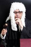 Portrait Of Male Lawyer with eyeglasses Holding Judge Gavel. On black background stock photography