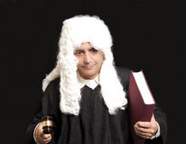 Portrait Of Male Lawyer Holding Judge Gavel And Book on black ba. Ckground royalty free stock image