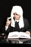 Portrait Of Male Lawyer With Judge Gavel And Book on black backg. Round royalty free stock photography