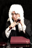 Portrait Of Male Lawyer with Judge Gavel And Book. On black background royalty free stock photo