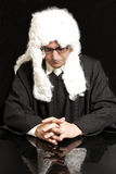 Portrait Of Male Lawyer in a wig with eyeglasses. On black background royalty free stock photos