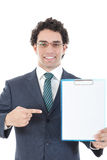 Portrait of a male manager holding a white board. Portrait of a male manager holding and showing with finger white board ih his hand, studio isolated on white Stock Photos