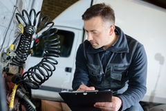 Portrait male mechanic at work in garage Royalty Free Stock Photography