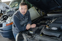 Portrait male mechanic at work in garage Stock Photography