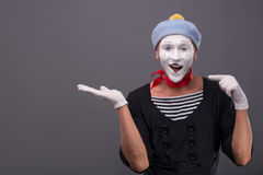 Portrait of male mime with grey hat and white face Stock Photo