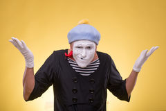 Portrait of male mime isolated on yellow Royalty Free Stock Photography