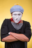 Portrait of male mime isolated on yellow Royalty Free Stock Images