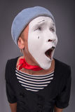Portrait of male mime in red head and with white Stock Photography