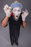 Portrait of male mime in red head and with white Royalty Free Stock Image