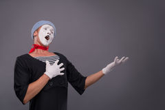 Portrait of male mime in red head and with white Royalty Free Stock Photography