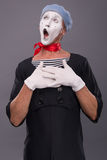 Portrait of male mime in red head and with white Royalty Free Stock Photo