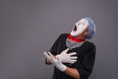 Portrait of male mime in red head and with white Royalty Free Stock Images