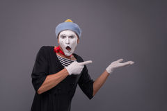 Portrait of male mime in red head and with white Stock Images