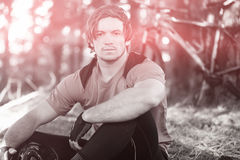 Portrait of male mountain biker in forest Stock Photos