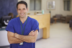 Portrait Of Male Nurse In Hospital Reception stock photos