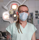 Portrait of  male nurse ICU  with tattoo and dreadlocks. Stock Photos