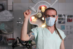 Portrait of  male nurse ICU  with tattoo and dreadlocks. Stock Photo