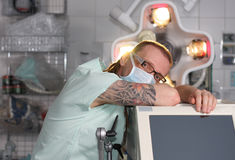 Portrait of  male nurse ICU  with tattoo and dreadlocks. Royalty Free Stock Photos
